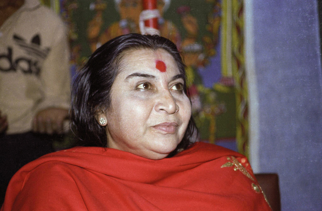 Shri Mataji Nirmala Devi, head and shoulders, with red shawl